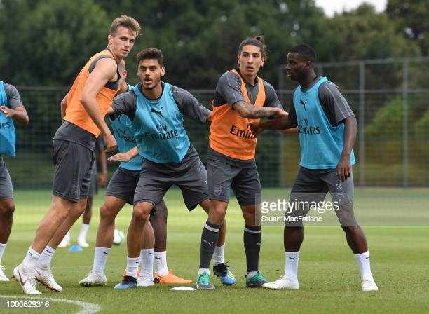 Rob Holding Konstantinos Mavropanos Hector Bellerin and Jordi OseiTutu of Arsenal during a training session at London Colney on July 17 2018 in St...