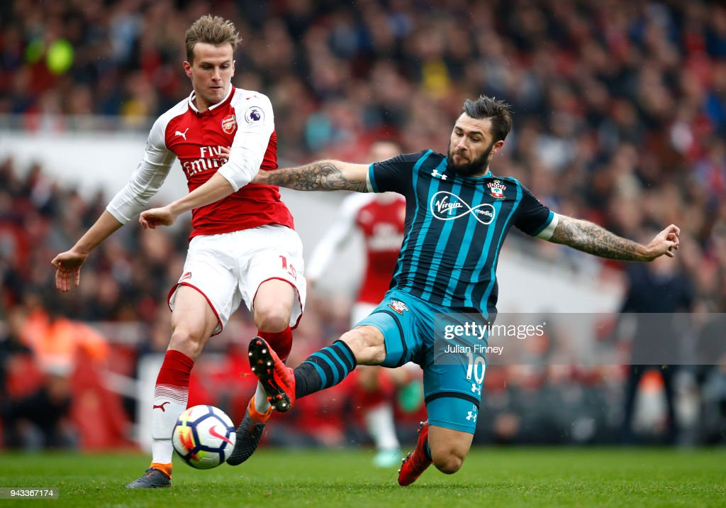 Rob Holding of Arsenal and Charlie Austin of Southampton battle for possession during the Premier League match between Arsenal and Southampton at Emirates Stadium on April 8, 2018 in London, England.