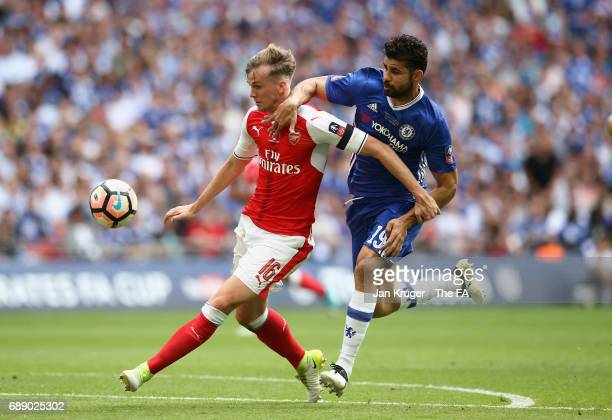 Rob Holding of Arsenal and Diego Costa of Chelsea challenge for the ball during the Emirates FA Cup Final between Arsenal and Chelsea at Wembley...