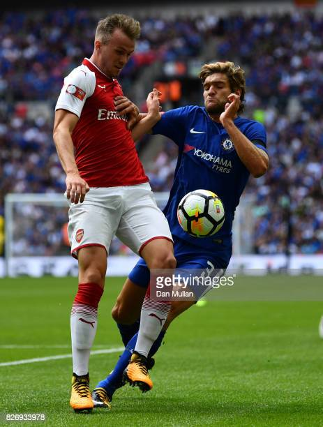 Rob Holding of Arsenal and Marcos Alonso of Chelsea battle for possession during the The FA Community Shield final between Chelsea and Arsenal at...