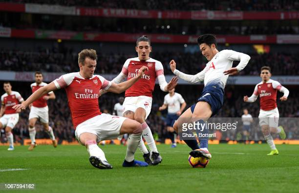 Rob Holding of Arsenal battles for possession with Heung-Min Son of Tottenham Hotspur leading to Tottenham Hotspur's penalty during the Premier...