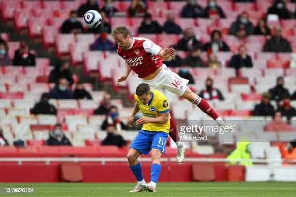 Rob Holding of Arsenal beating Leandro Trossard of Brighton & Hove Albion to the header during the Premier League match between Arsenal and Brighton...
