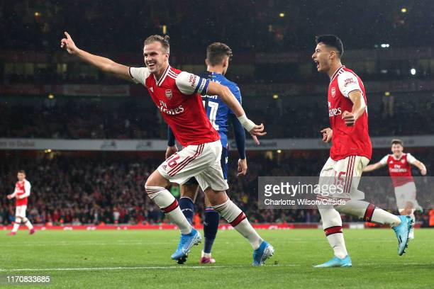 Rob Holding of Arsenal celebrates scoring their 2nd goal during the Carabao Cup Third Round match between Arsenal and Nottingham Forest at Emirates...