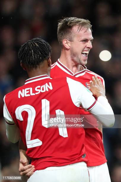 Rob Holding of Arsenal celebrates scoring their 2nd goal with Reiss Nelson during the Carabao Cup Third Round match between Arsenal and Nottingham...
