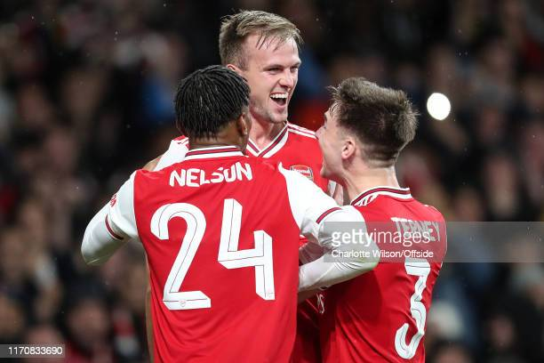 Rob Holding of Arsenal celebrates scoring their 2nd goal with Reiss Nelson and Kieran Tierney during the Carabao Cup Third Round match between...