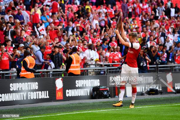 Rob Holding of Arsenal celebrates with the trophy following the The FA Community Shield final between Chelsea and Arsenal at Wembley Stadium on...