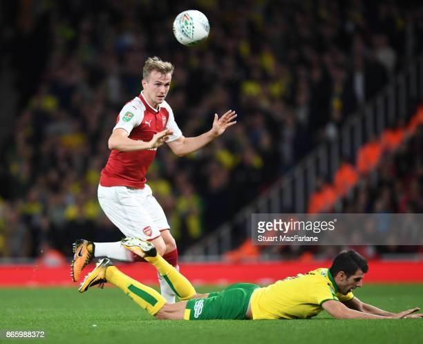 Rob Holding of Arsenal challenged by Mario Vrancic of Norwich during the Carabao Cup Fourth Round match between Arsenal and Norwich City at Emirates...