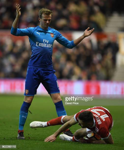 Rob Holding of Arsenal challenges Ben Brereton of Forest during the Emirates FA Cup 3rd Round match between Nottingham Forest and Arsenal at City...