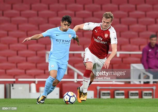 Rob Holding of Arsenal challenges Brahim Diaz of Man City during the match between Arsenal U23 and Manchester City U23 at Emirates Stadium on August...