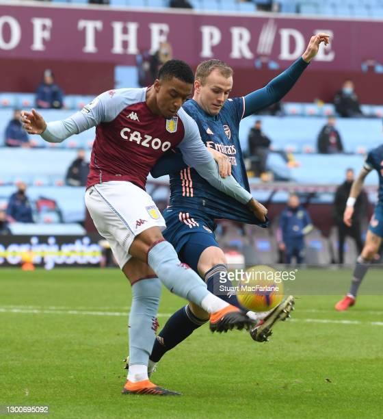 Rob Holding of Arsenal challenges Ezri Konsa Nhoyo of Aston Villa during the Premier League match between Aston Villa and Arsenal at Villa Park on...