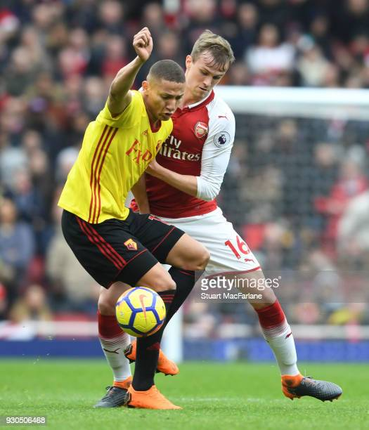 Rob Holding of Arsenal challenges Richarlison of Watford during the Premier League match between Arsenal and Watford at Emirates Stadium on March 10...