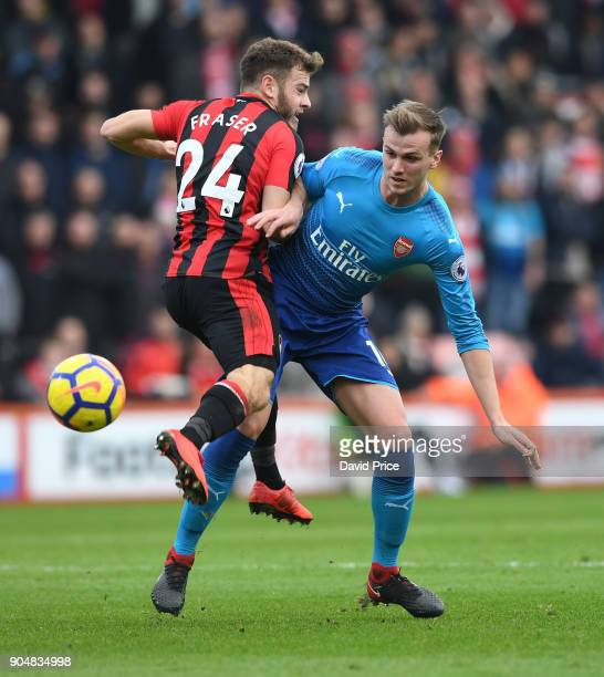 Rob Holding of Arsenal challenges Ryan Fraser of Bournemouth during the Premier League match between AFC Bournemouth and Arsenal at Vitality Stadium...