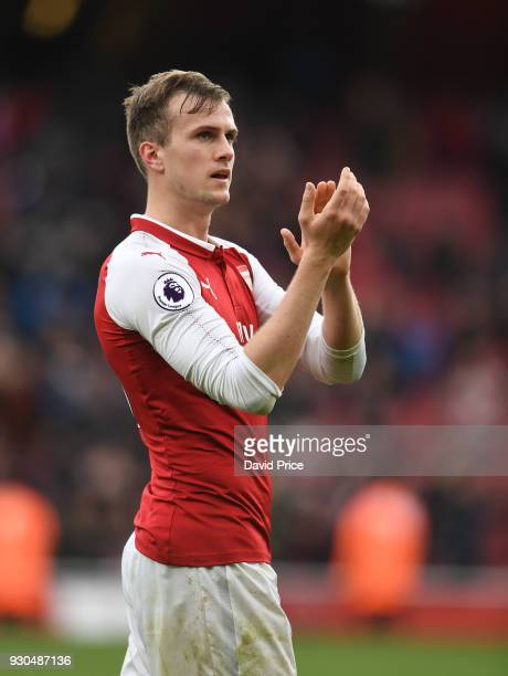 Rob Holding of Arsenal claps the fans after the Premier League match between Arsenal and Watford at Emirates Stadium on March 11 2018 in London...