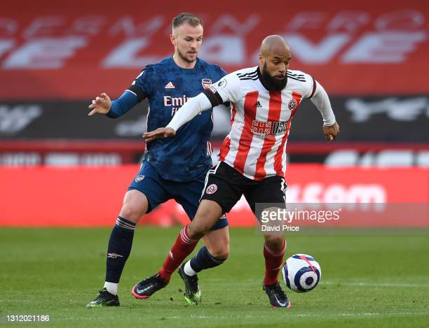 Rob Holding of Arsenal closes down David McGoldrick of Sheffield United during the Premier League match between Sheffield United and Arsenal at...