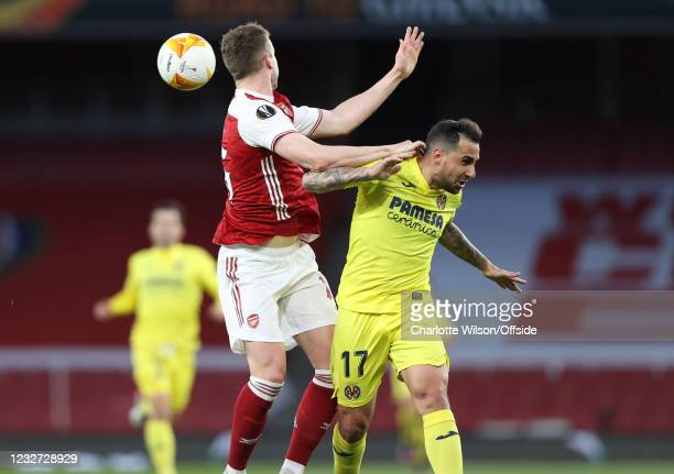 Rob Holding of Arsenal heads clear from Paco Alcacer of Villarreal during the UEFA Europa League Semi-final Second Leg match between Arsenal and...