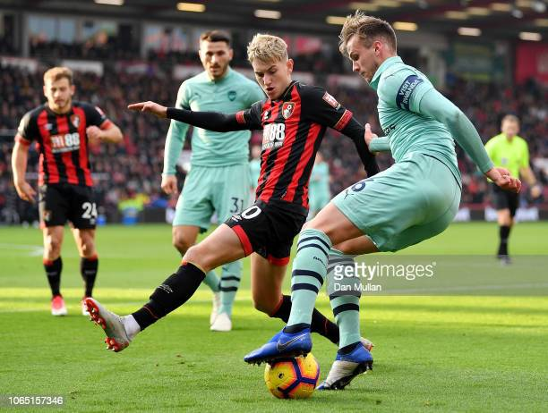 Rob Holding of Arsenal holds off David Brooks of AFC Bournemouth during the Premier League match between AFC Bournemouth and Arsenal FC at Vitality...