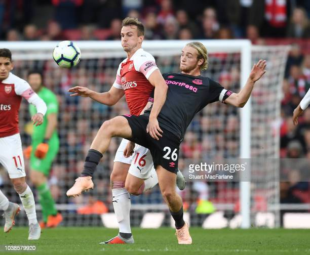 Rob Holding of Arsenal holds off Tom Davies of Everton during the Premier League match between Arsenal FC and Everton FC at Emirates Stadium on...