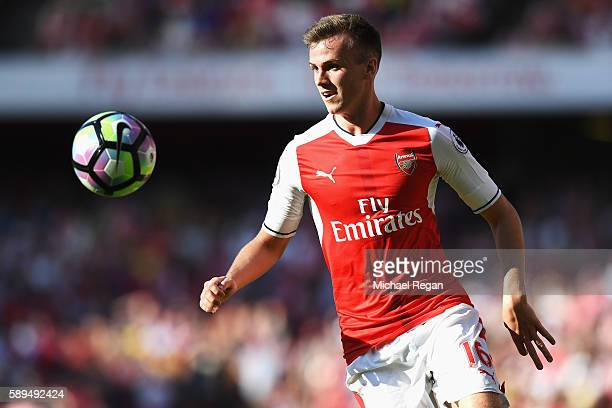 Rob Holding of Arsenal in action during the Premier League match between Arsenal and Liverpool at Emirates Stadium on August 14 2016 in London England