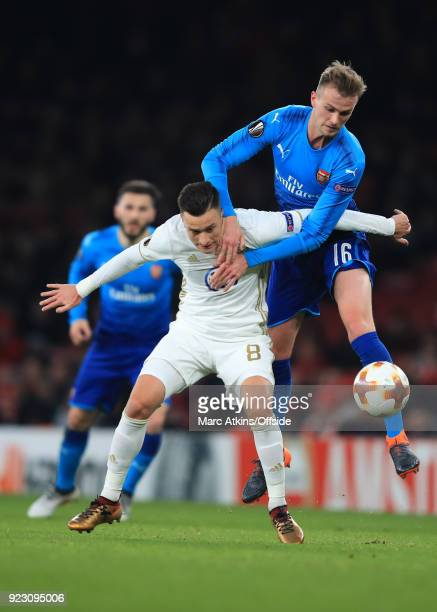 Rob Holding of Arsenal in action with Jamie Hopcutt of Ostersunds FK during the UEFA Europa League Round of 32 match between Arsenal and Ostersunds...