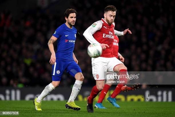 Rob Holding of Arsenal is closed down by Cesc Fabregas of Chelsea during the Carabao Cup SemiFinal First Leg match between Chelsea and Arsenal at...