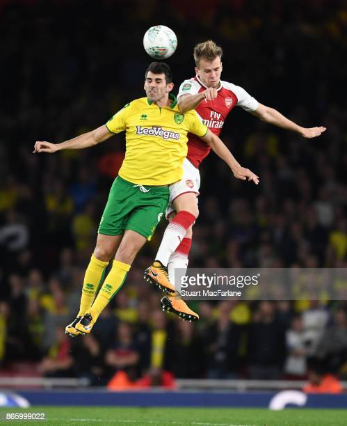 Rob Holding of Arsenal outjumps Mario Vrancic of Norwich during the Carabao Cup Fourth Round match between Arsenal and Norwich City at Emirates...