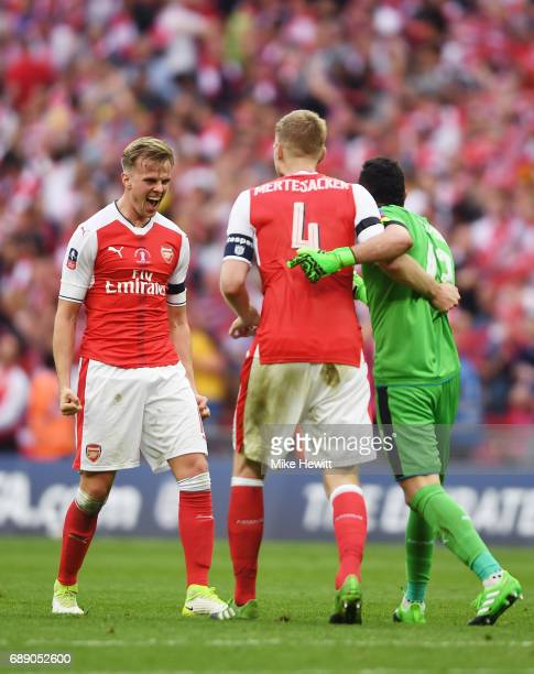 Rob Holding of Arsenal , Per Mertesacker of Arsenal and David Ospina of Arsenal celebrate after The Emirates FA Cup Final between Arsenal and Chelsea...