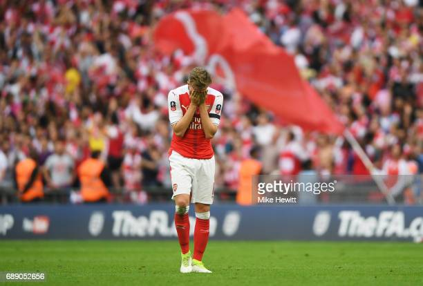 Rob Holding of Arsenal reacts to winning the FA Cup after The Emirates FA Cup Final between Arsenal and Chelsea at Wembley Stadium on May 27 2017 in...
