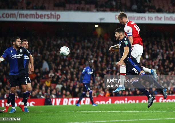 Rob Holding of Arsenal scores the second goal during the Carabao Cup Third Round match between Arsenal and Nottingham Forest at Emirates Stadium on...