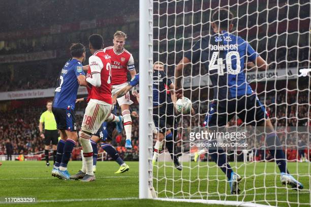 Rob Holding of Arsenal scores their 2nd goal during the Carabao Cup Third Round match between Arsenal and Nottingham Forest at Emirates Stadium on...
