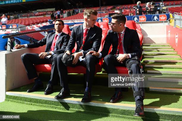 Rob Holding of Arsenal speaks to Gabriel of Arsenal on the bench prior to The Emirates FA Cup Final between Arsenal and Chelsea at Wembley Stadium on...