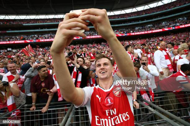 Rob Holding of Arsenal takes a selfie with the Arsenal fans after the Emirates FA Cup Final between Arsenal and Chelsea at Wembley Stadium on May 27,...