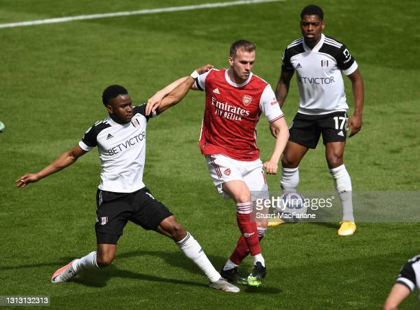 Rob Holding of Arsenal takes on Ademola Lookman of Fulham during the Premier League match between Arsenal and Fulham at Emirates Stadium on April 18,...