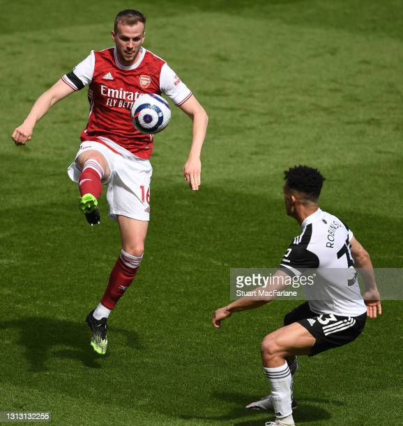Rob Holding of Arsenal takes on Antonee Robinson Fulham during the Premier League match between Arsenal and Fulham at Emirates Stadium on April 18,...