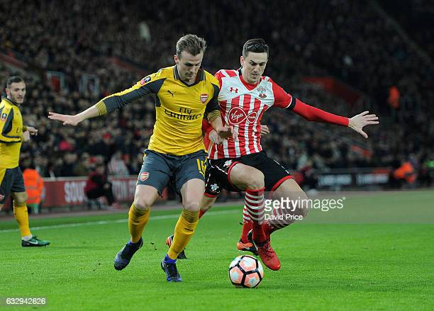 Rob Holding of Arsenal takes on Florin Gardos of Southampton during the match between Southampton and Arsenal at St Mary's Stadium on January 28 2017...