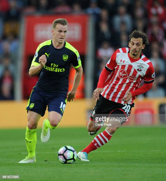 Rob Holding of Arsenal takes on Manolo Gabbiadini of Southampton during the Premier League match between Southampton and Arsenal at St Mary's Stadium...