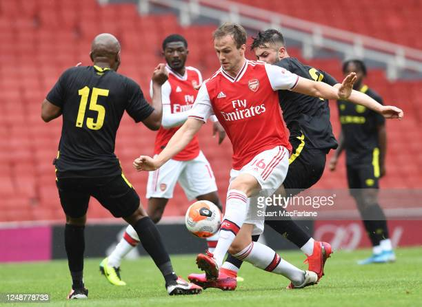 Rob Holding of Arsenal takes on Marcus Forss of Brentford during a friendly match between Arsenal and Brentford at Emirates Stadium on June 10 2020...