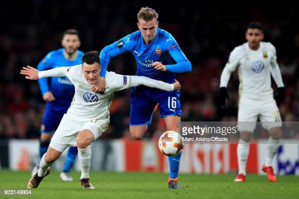 Rob Holding of Arsenal tangles with Jamie Hopcutt of Ostersunds FK during the UEFA Europa League Round of 32 match between Arsenal and Ostersunds FK...