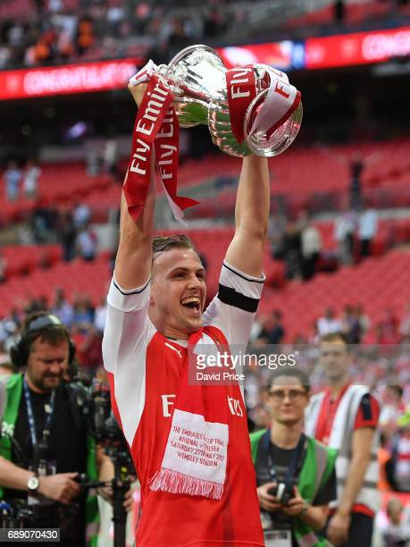 Rob Holding of Arsenal with the FA Cup Trophy after the match between Arsenal and Chelsea at Wembley Stadium on May 27 2017 in London England