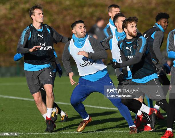 Rob Holding Sead Kolasinac and Calum Chambers of Arsenal during a training session at London Colney on December 9 2017 in St Albans England