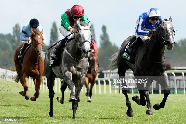 Rob Hornby riding Technician win The Unibet Geoffrey Freer Stakes from Mornado and Silvestre De Sousa at Newbury Racecourse on August 17, 2019 in...