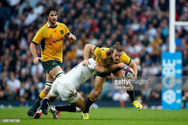 Rob Horne of Australia is tackled by Billy Twelvetrees of England during the QBE international match between England and Australia at Twickenham...