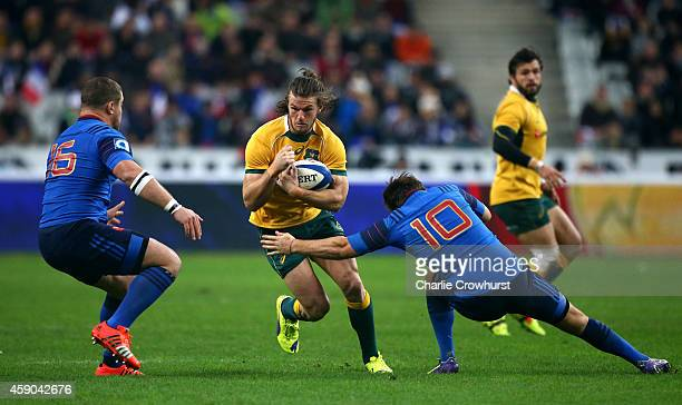 Rob Horne of Australia looks to get past France's Benjamin Kayser and Camille Lopez during the International match between France and Australia at...