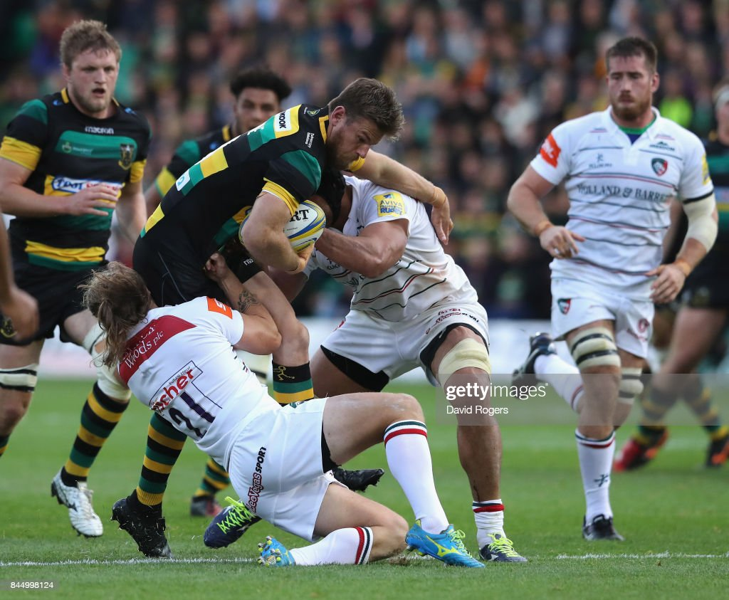 Rob Horne of Northampton is tackled by Sam Harrison during the Aviva Premiership match between Northampton Saints and Leicester Tigers at Franklin's Gardens on September 9, 2017 in Northampton, England.