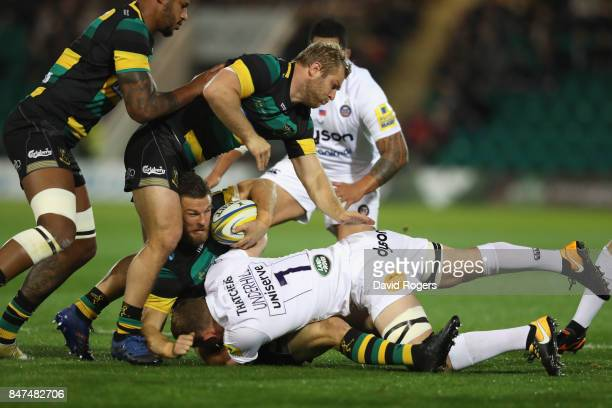 Rob Horne of Northampton is tackled by Sam Underhill during the Aviva Premiership match between Northampton Saints and Bath Rugby at Franklin's...
