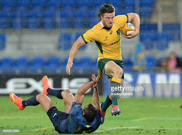 Rob Horne of the Wallabies breaks through the defence during The Rugby Championship match between the Australian Wallabies and Argentina at Cbus...