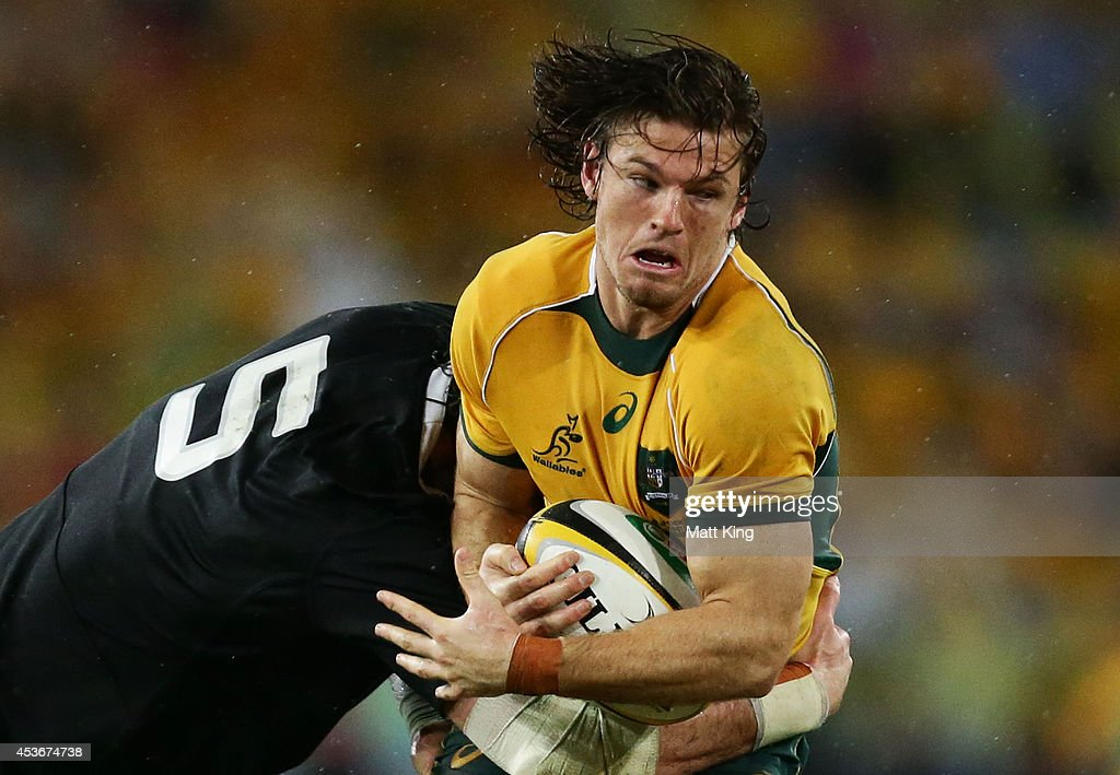 Rob Horne of the Wallabies is tackled during The Rugby Championship match between the Australian Wallabies and the New Zealand All Blacks at ANZ Stadium on August 16, 2014 in Sydney, Australia.