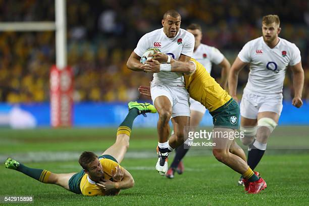 Rob Horne of the Wallabies misses a tackle on Jonathan Joseph of England during the International Test match between the Australian Wallabies and...