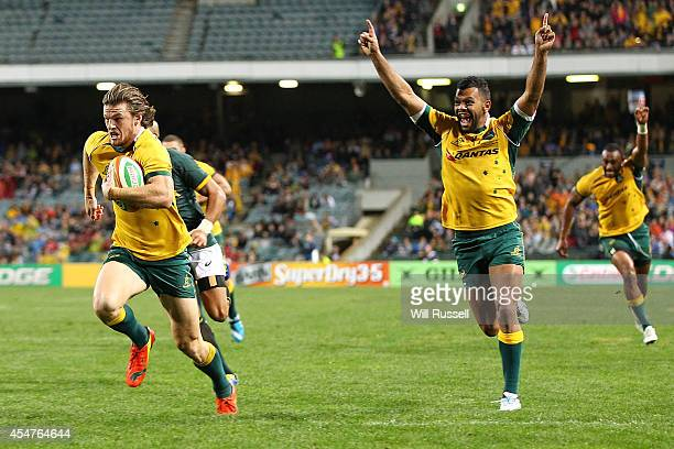 Rob Horne of the Wallabies runs to the try line as Kurtley Beale of the Wallabies celebrates during The Rugby Championship match between the...