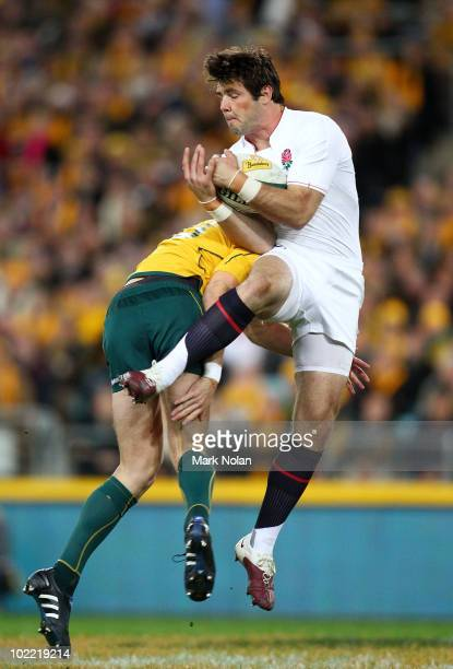 Rob Horne of the Wallabies tackles Ben Foden of England during the Cook Cup Test Match between the Australian Wallabies and England at ANZ Stadium on...