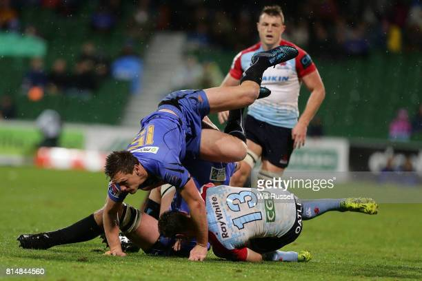 Rob Horne of the Waratahs is tackled by Dane HaylettPetty and Ross HaylettPetty of the Force during the round 17 Super Rugby match between the Force...